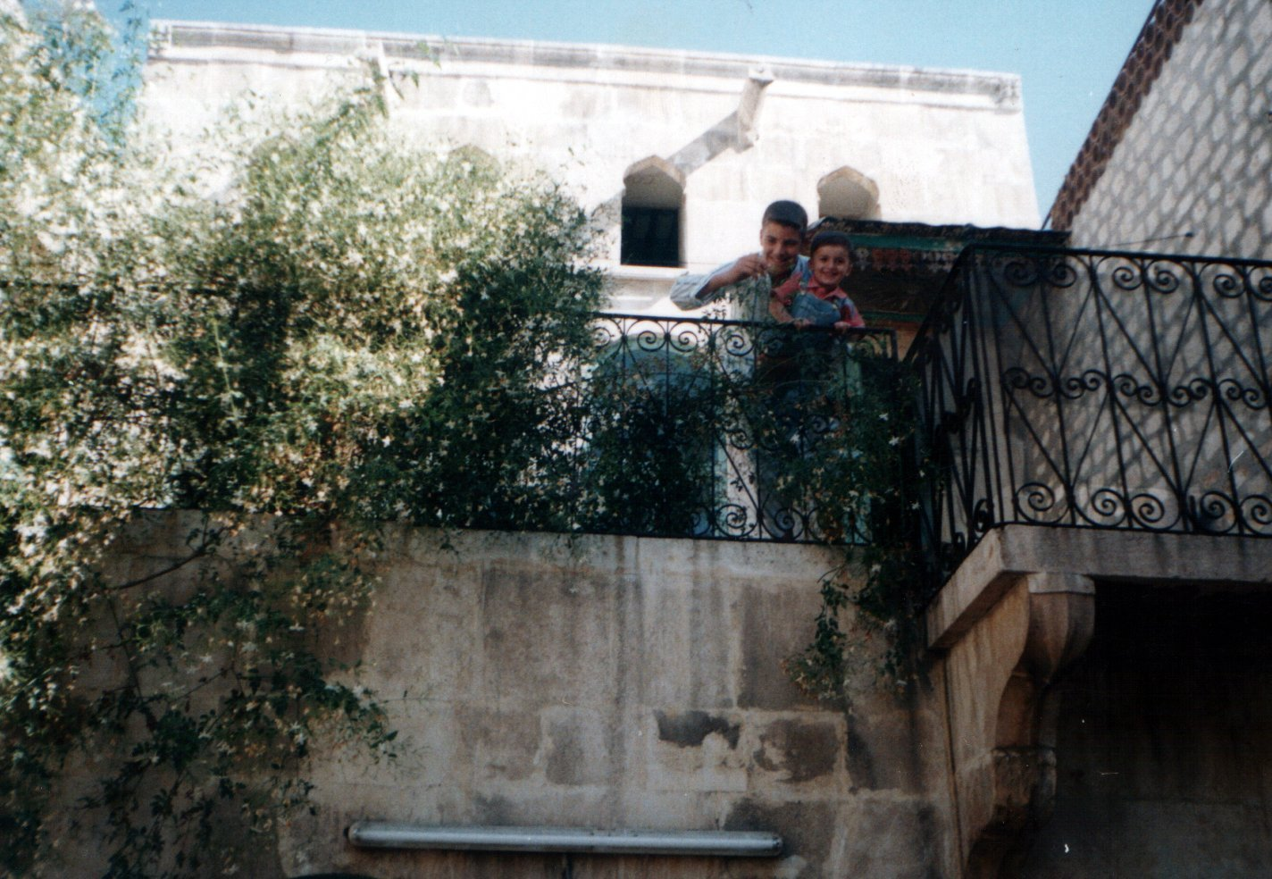 Hakam holding younger brother Shahim - around 2000