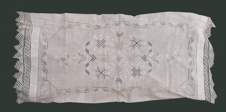 Image 3: Pillowcase full of eight-edged starts common in Armenian Needlework