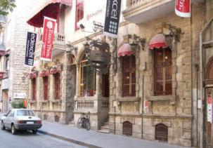 """A historical building, Iskenderun Street, al-Jamiliye"" by Vito Press"