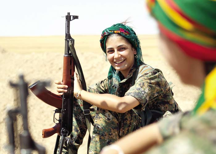 Female fighter from the Kurdish People Protection Unit. The Arab Weekly.