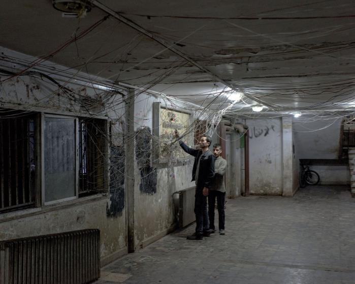 IDPs in former university housing building. Lorenzo Meloni/Magnum Photos Aleppo Project.