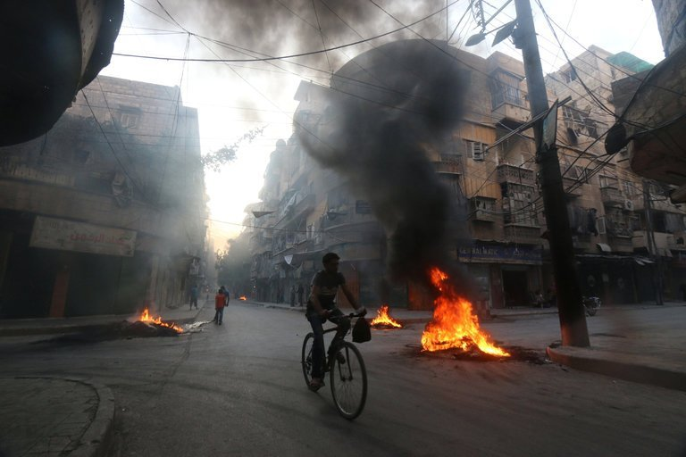 Burning tires in Aleppo to create smoke cover from airstrikes. August 2016. Photo: Abdalrhman Ismail/Reuters